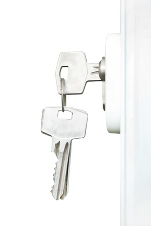 Keys in door lock, isolated on white Stock Photo - 15353053