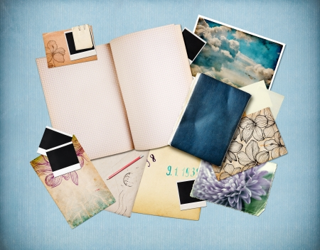 Vintage background with old paper, cards and instant photos, blue paper at background  photo