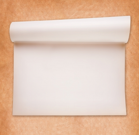 Scroll smooth paper on textured paper background photo