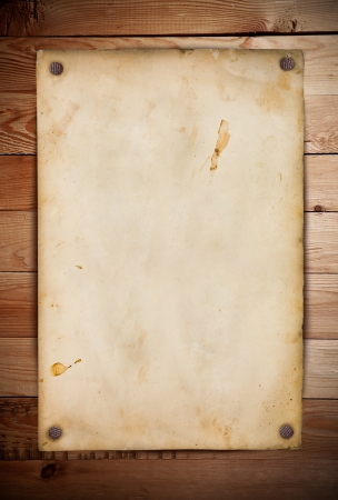 pinned: Old paper on the wood background