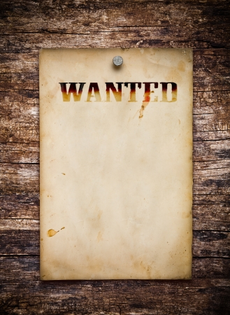 Wanted poster on old wooden wall  photo