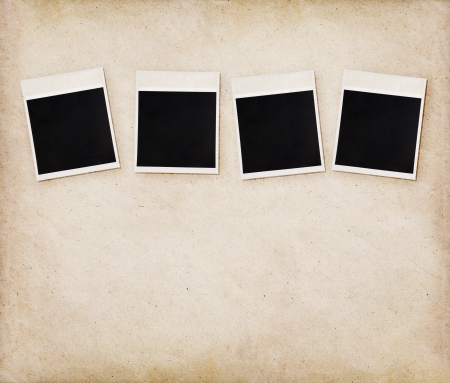 confines: Empty instant photos on old paper texture