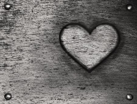 Metal heart on metal plate  photo