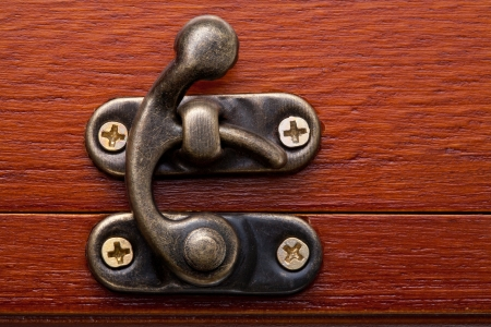pawl: Bronze lock of a wooden red chest