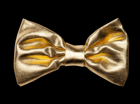 gold colour: Golden bow, isolated on black Stock Photo