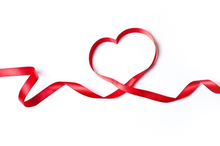 Red heart ribbon, on white background Reklamní fotografie