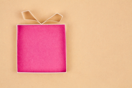 Hand made empty gift box, textured paper as background. Free space for text. Greeting card Stock Photo - 17948272