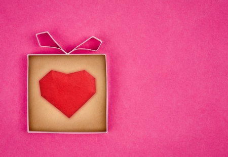 Hand made gift box with heart inside, textured  paper as background. Greeting card  photo