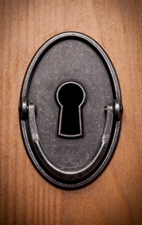 Closeup of an old keyhole on a wooden door Stock Photo - 17948330