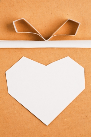 Hand made paper heart on kraft paper as background. Greeting card photo