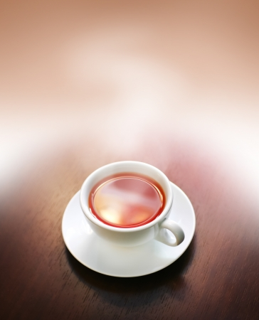 tabletop: Cup of steaming tea on wooden table, macro, template design Stock Photo