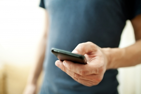 a communication: Close up of a man using mobile smart phone  Stock Photo