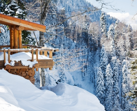 log cabin winter: Wooden ski chalet in snow, mountain view Stock Photo