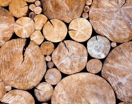 woodpile: Stacked logs, wooden background Stock Photo