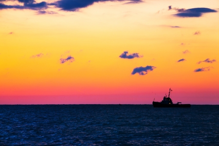 Fishing ship at sea with sunset  photo