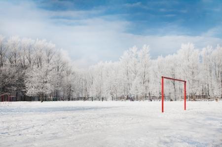 snow field: Empty football gate in winter season