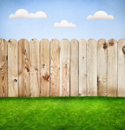 Wooden fence in a green grass, template design  photo