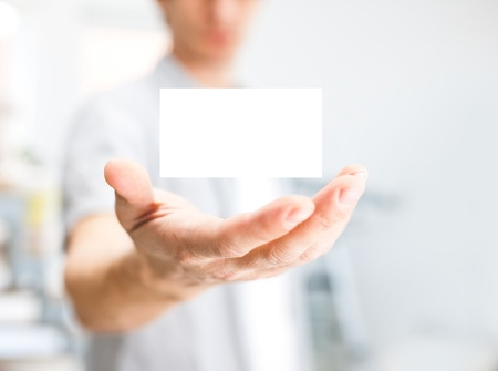 people holding sign: Man holding blank business card with copy space, small dof