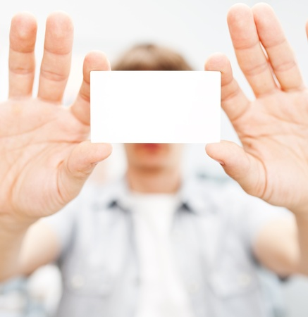 Man holding blank business card with copy space, small dof  photo