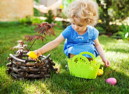 egg hunt: Little Girl on an Easter Egg hunt on a meadow in spring