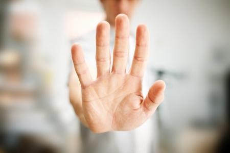 stop gesture: Man showing stop gesture