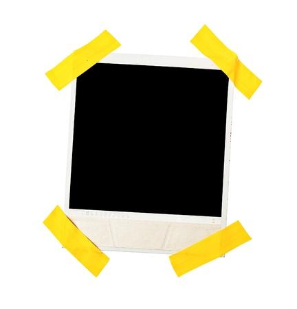 papel quemado: Marco de fotos estilo polaroid sujetada con cinta adhesiva, aislados en blanco