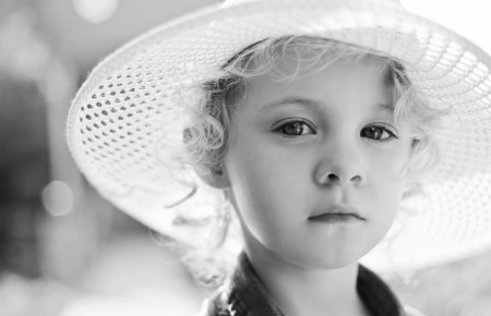 backlite: Blonde baby girl  outdoor. Closeup black and white vintage portrait Stock Photo