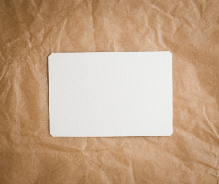 pack string: Brown craft paper with a blank tag on a white background  Stock Photo
