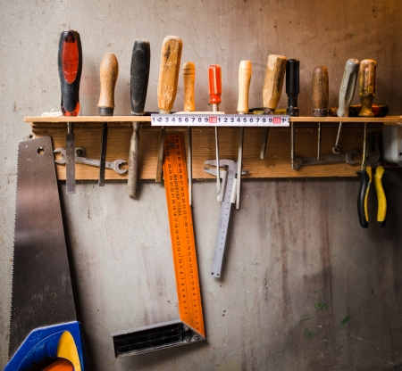 orderly: Assortment of tools hanging on the wall
