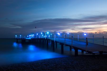 Wooden pier on the sea, after sunset photo