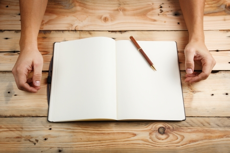 drawing table: In Search Of Inspiration. A man with an empty notebook.  Stock Photo