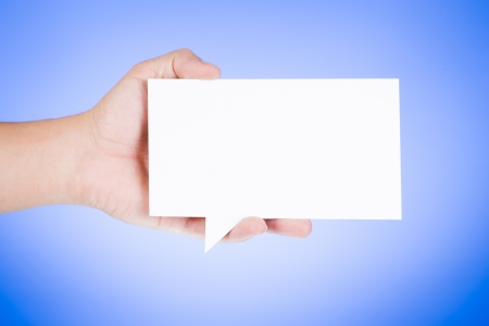 Man holding blank paper speech bubble  photo