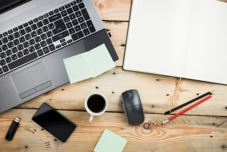 open diary: Workplace, laptop and notepad on wooden table