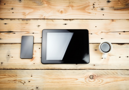 Tablet pc on wooden table photo