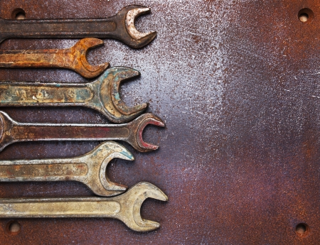 toolkit: Old wrenches on a metal table