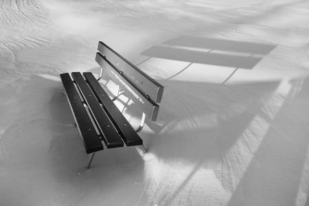 snowlandscape: Wooden bench in snowy white landscape  Stock Photo