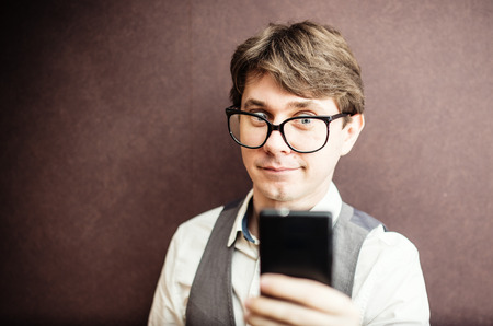 Funny guy using mobile smartphone  photo