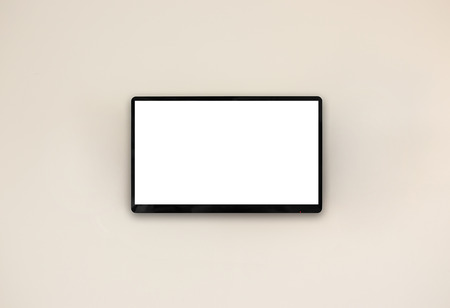 fullhd: Led tv hanging on the wall background Stock Photo