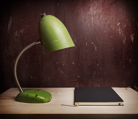 blind person: Retro green desk lamp on wooden table Stock Photo
