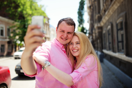pic: Happy couple taking photo of themselves or making selfie by smartphone