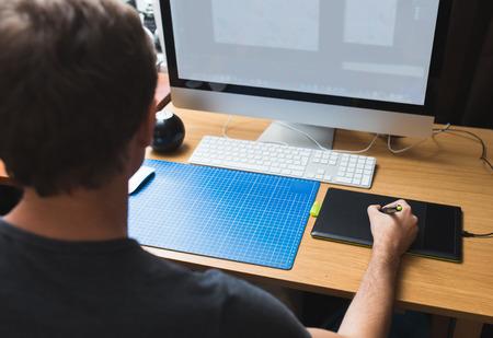 Freelance developer or designer working at home photo
