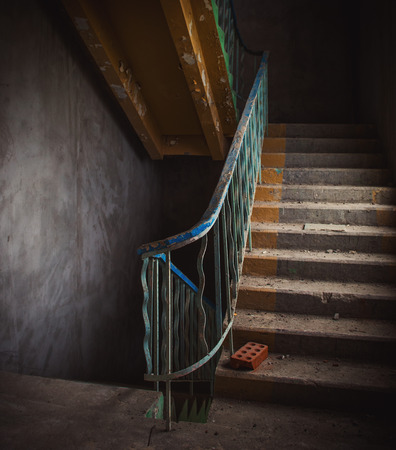 stairs interior: Vintage staircase and dirty floor in abandoned building interior.
