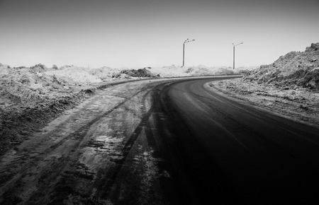 space weather tire: Snow-covered road, the marks of wheels, black and white  photo