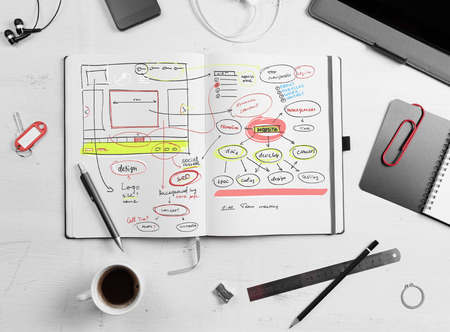 Developer workplace. Open notepad with hand drawn website project. Stok Fotoğraf - 33975985