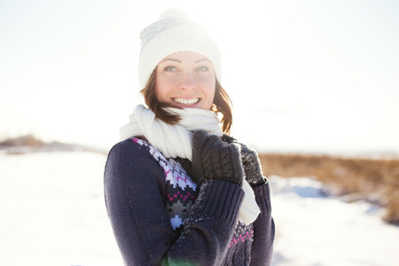 Happy young woman have fun and enjoy fresh snow at beautiful winter day Banco de Imagens