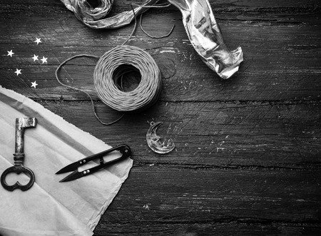 Decoration elements for craft on old wooden table. Decorator workplace. Black and white photo photo