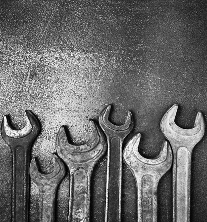 bw: Old wrenches on a metal table, bw photo