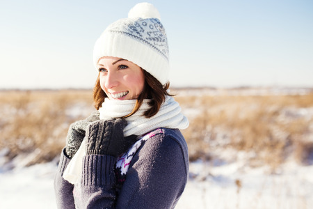 Portrait of happy young woman have fun at beautiful sunny winter day Foto de archivo