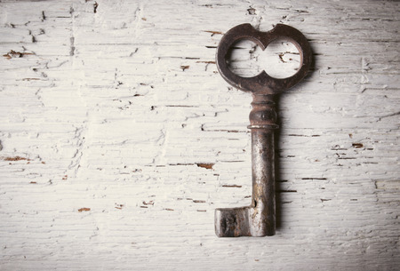 Old key on wooden table photo