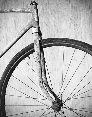 Old rusty bicycle, black and white photo photo